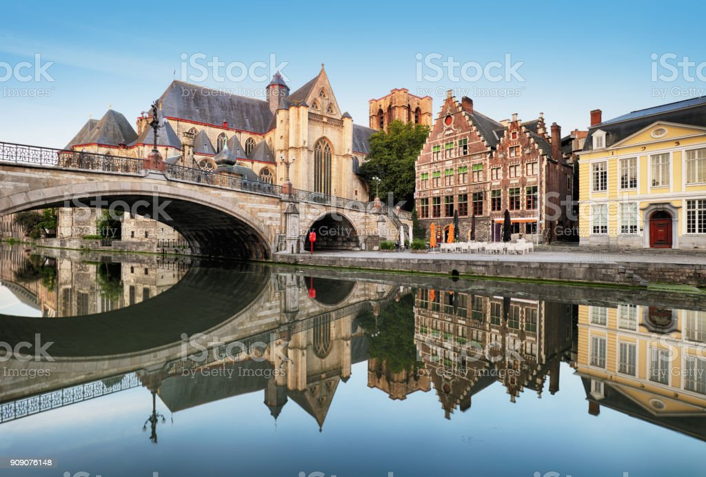 Gent - Medieval cathedral and bridge over a canal in Ghent, Belgium stock photo