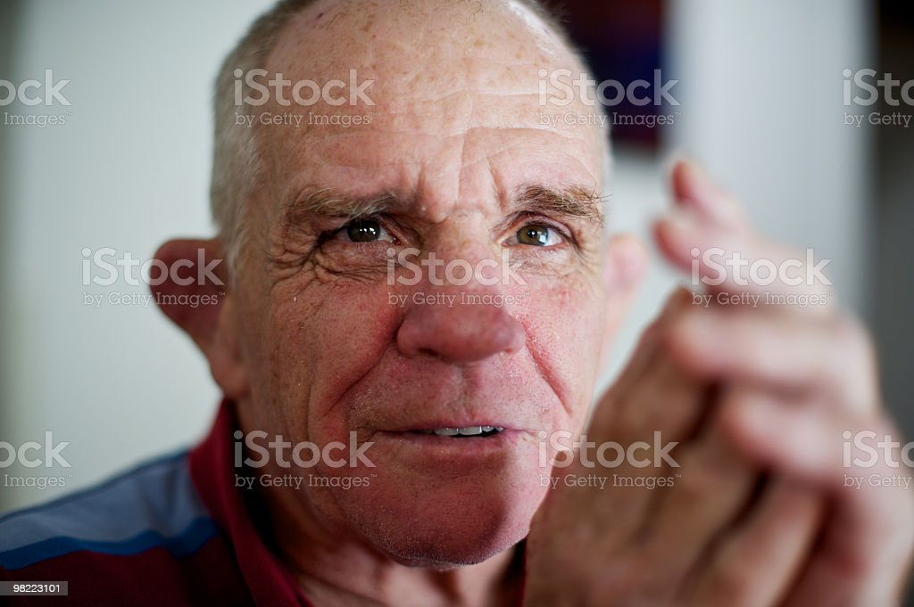 Gentle eyed man with a disability in his sixties royalty-free stock photo