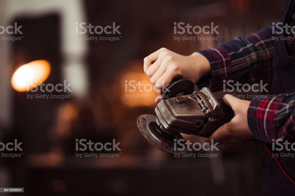Gentle Female Hands Showing Power Tool - Grinder