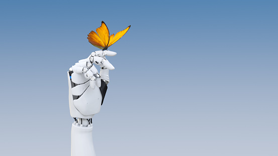 A yellow butterfly poised on a robot finger