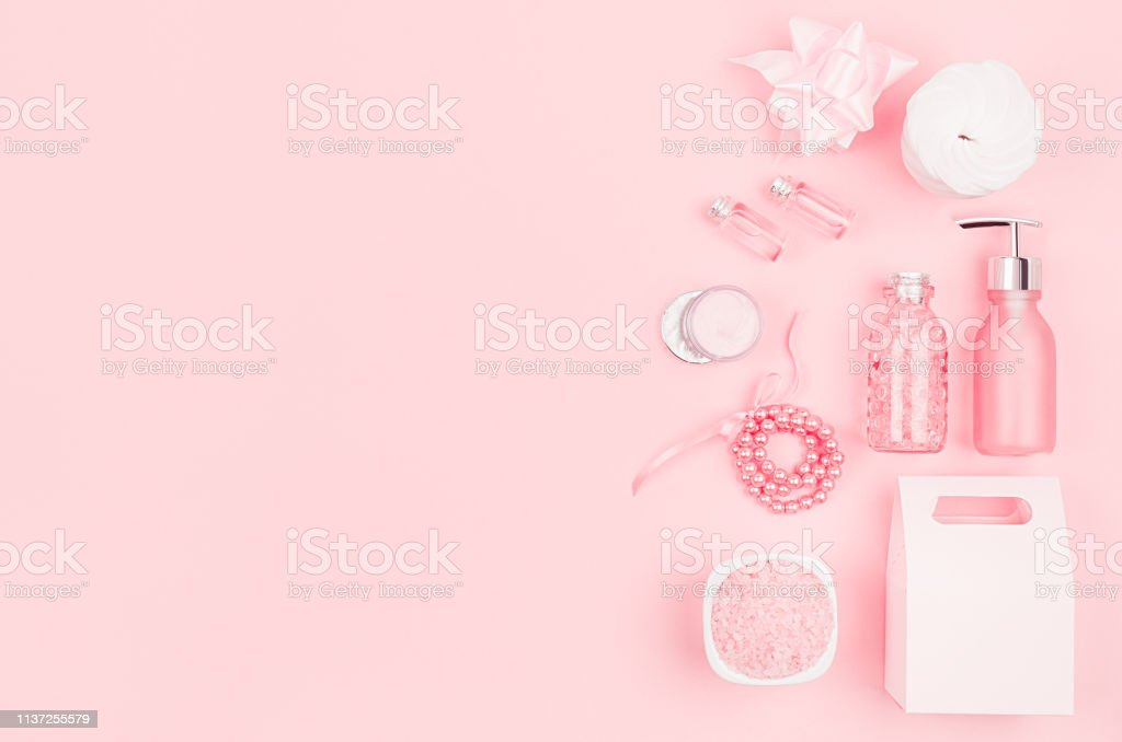 Gentle soft pink cosmetic set for body and skin care, makeup - cream,...