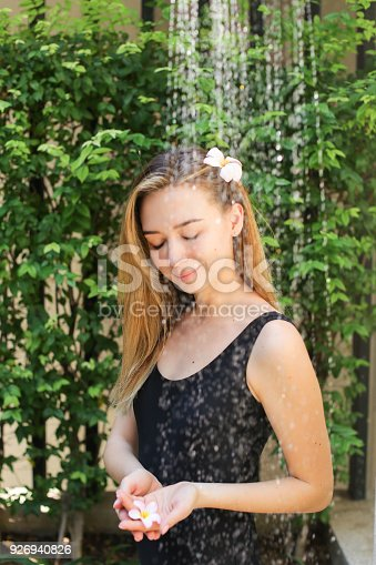 545091450istockphoto gentle soft portrait of girl who is bathed in street in shower w 926940826