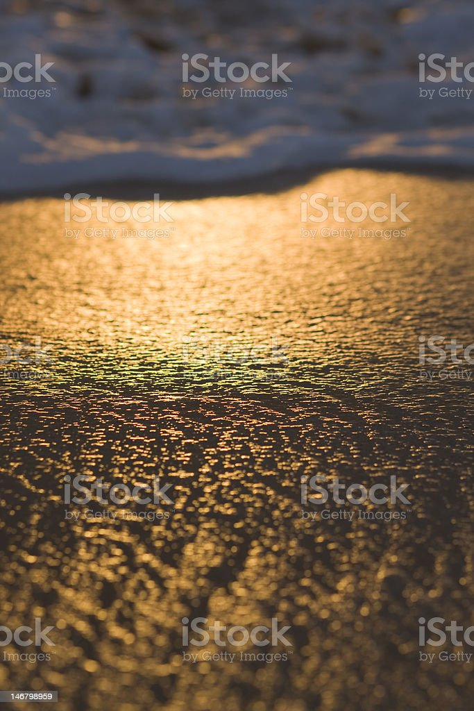 Gentle Surf on Golden Sand stock photo