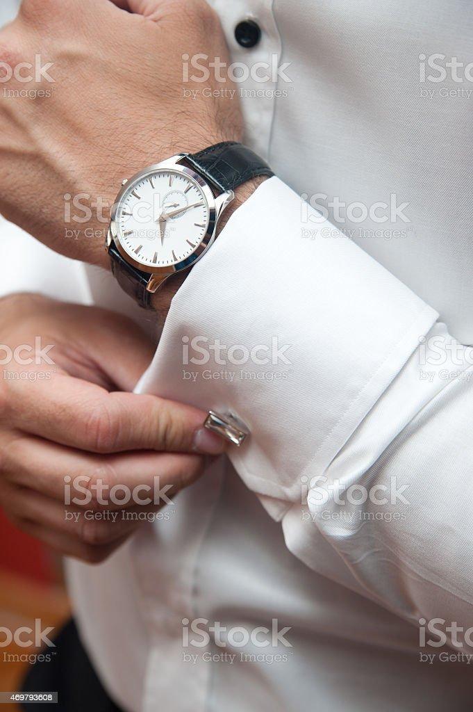 Gentleman adjusting cufflinks stock photo