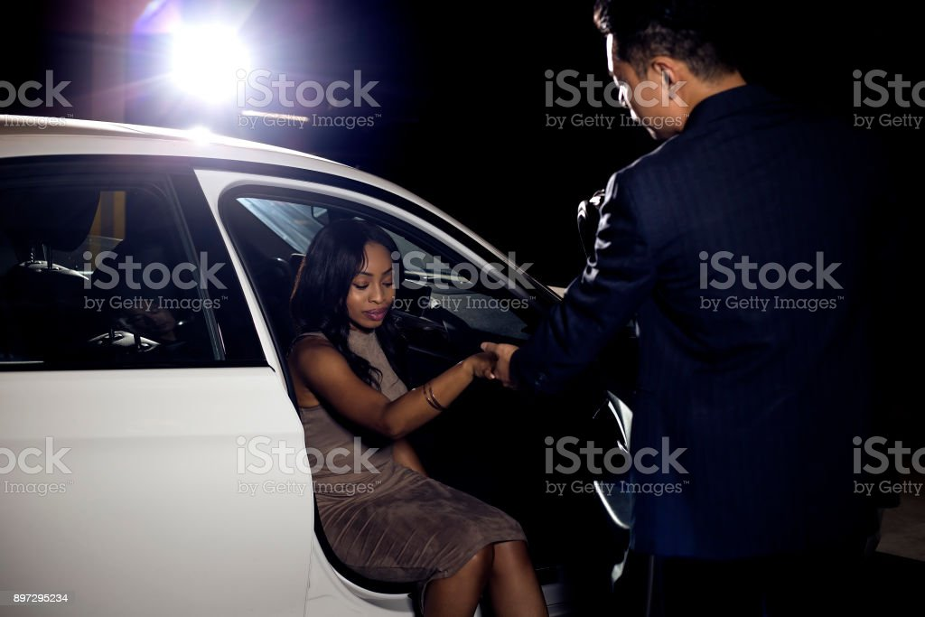 Gentleman Assisting Date Out of a Car stock photo