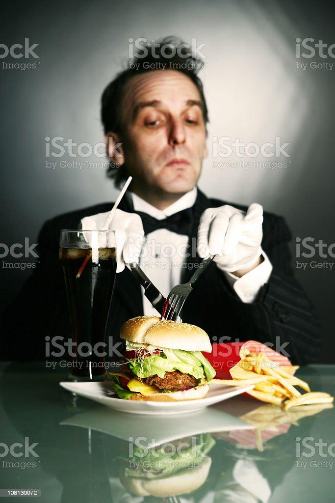 Gentleman eating burger royalty-free stock photo