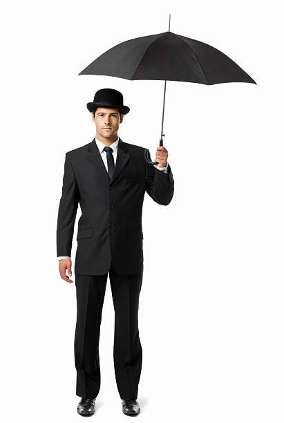 gentleman segurando um guarda-chuva-isolada - homem chapéu imagens e fotografias de stock
