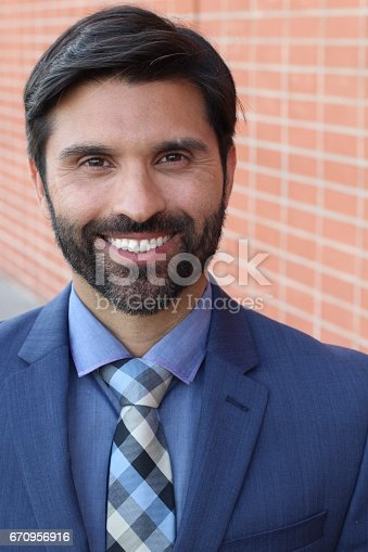 istock Gentleman in classic outfit smiling 670956916