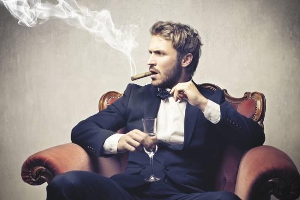 gentleman - guy with cigar stockfoto's en -beelden