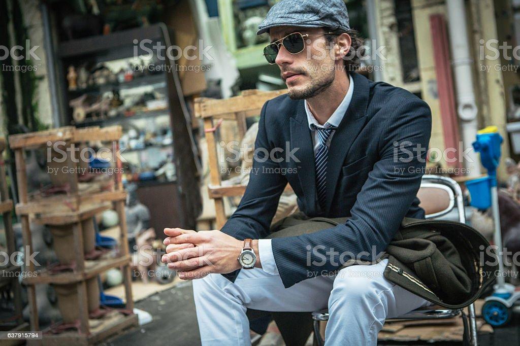Gentleman sitting stock photo
