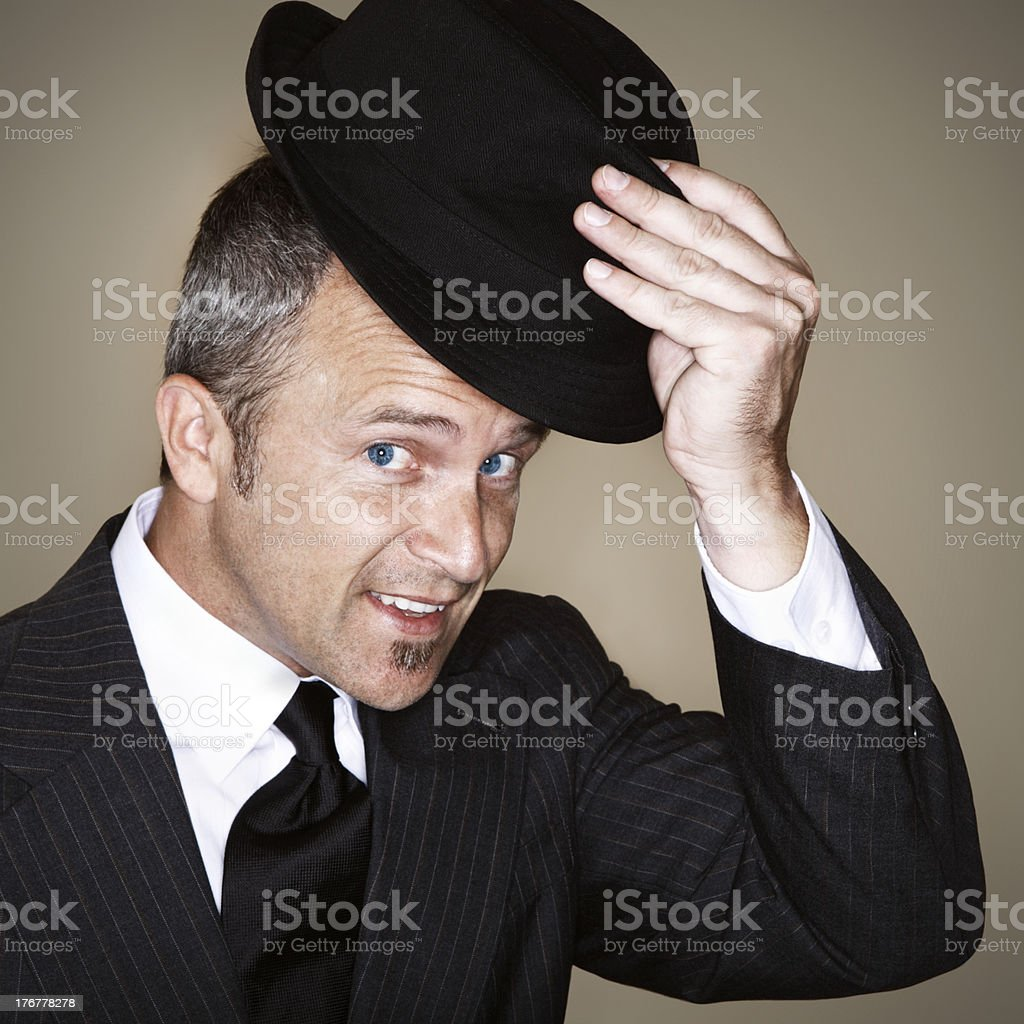 Gentleman Tipping Fedora royalty-free stock photo
