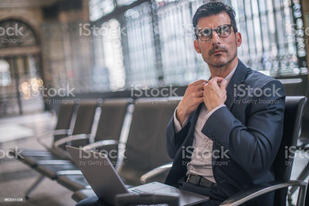 Gentleman using laptop stock photo