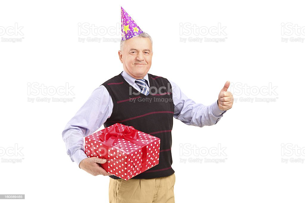 Gentleman with hat holding gift and giving a thumb up royalty-free stock photo
