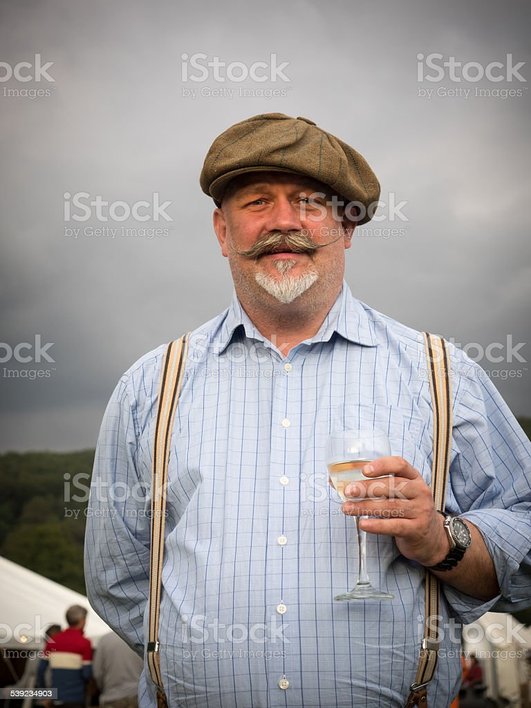 Gentleman with moustache and wine royalty-free stock photo