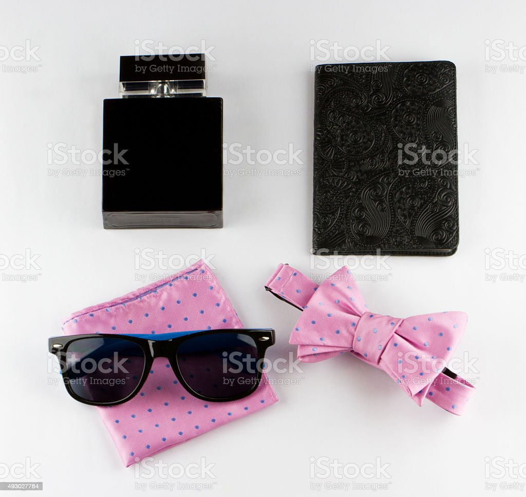 Gentlemanly set: perfume, bow tie, scarf, sunglasses, passport stock photo