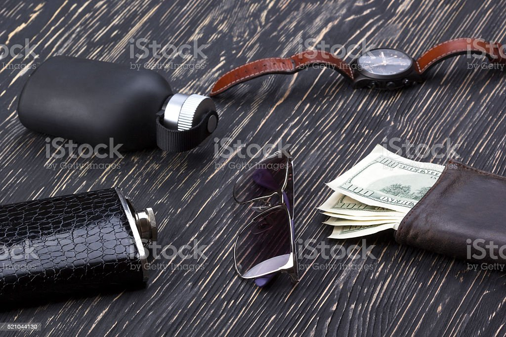 gentlemanly set:  sunglasses, perfume, wallet, flask, watch on wooden background stock photo