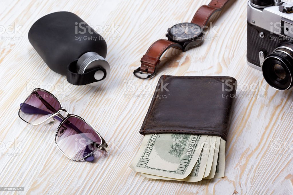 gentlemanly set:  sunglasses, perfume, wallet,camera, watch on wooden background stock photo
