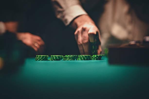 Gentlemen holding gambling chips in casino stock photo