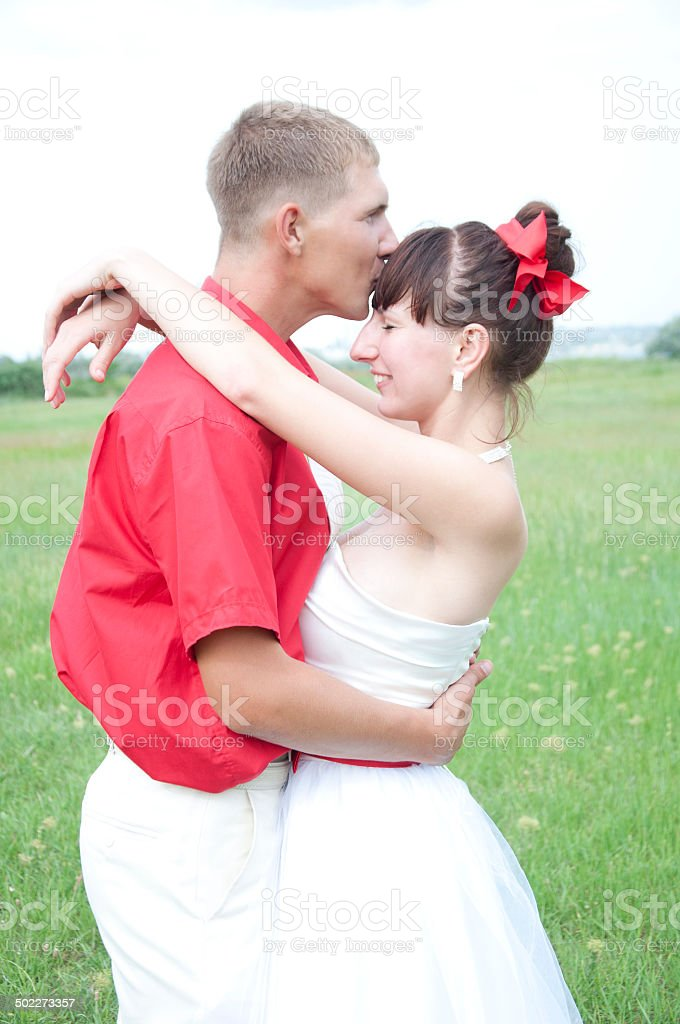 gently groom kisses the bride royalty-free stock photo