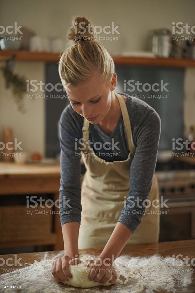 Gently kneading her dough stock photo