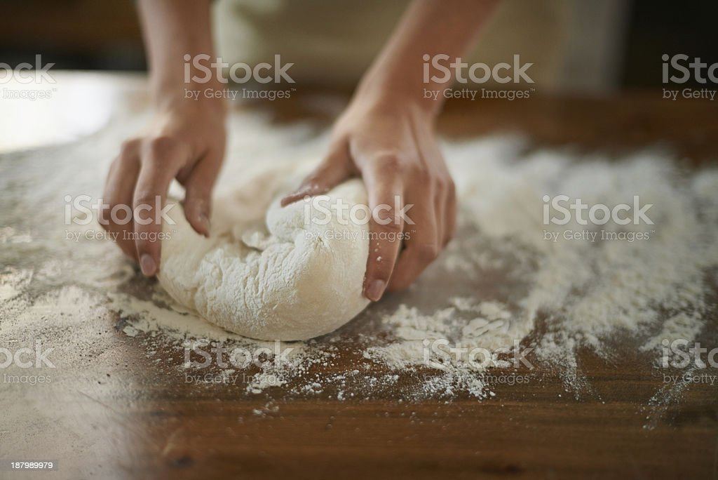 Gently working the dough stock photo