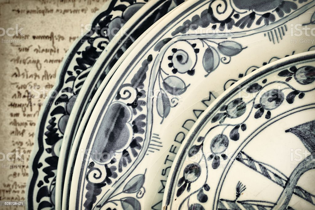 Genuine ancient Dutch blue and white porcelain dishware stock photo