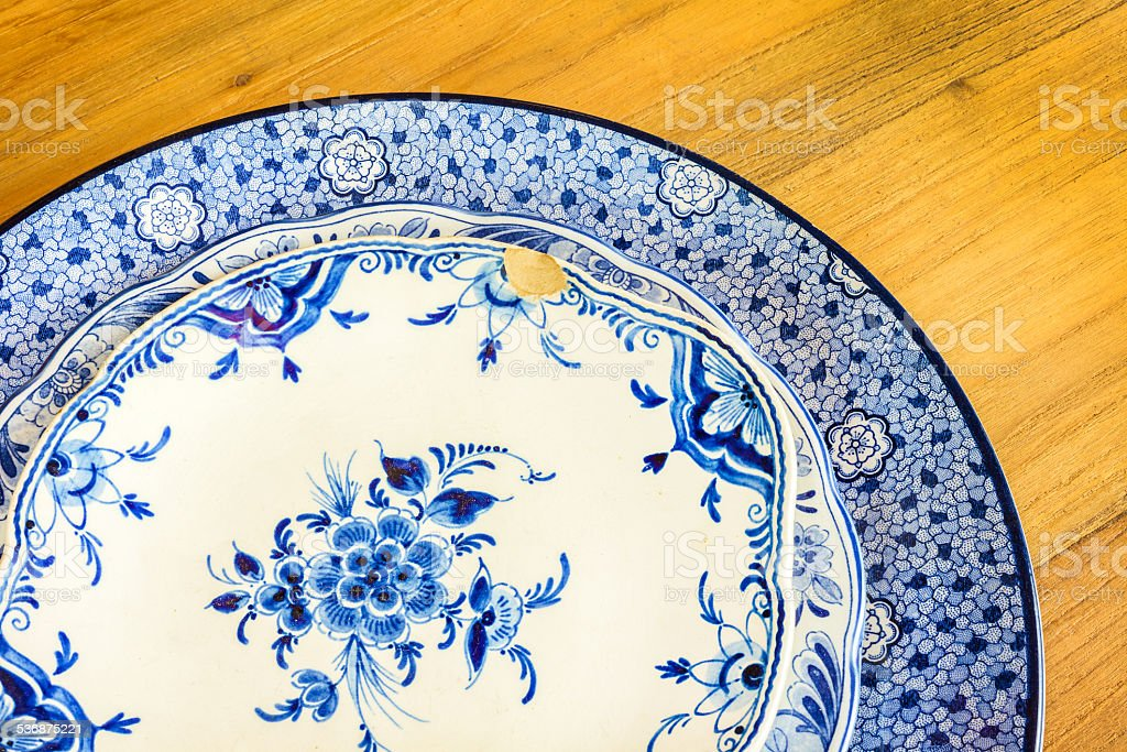Genuine antique dinner plates stock photo