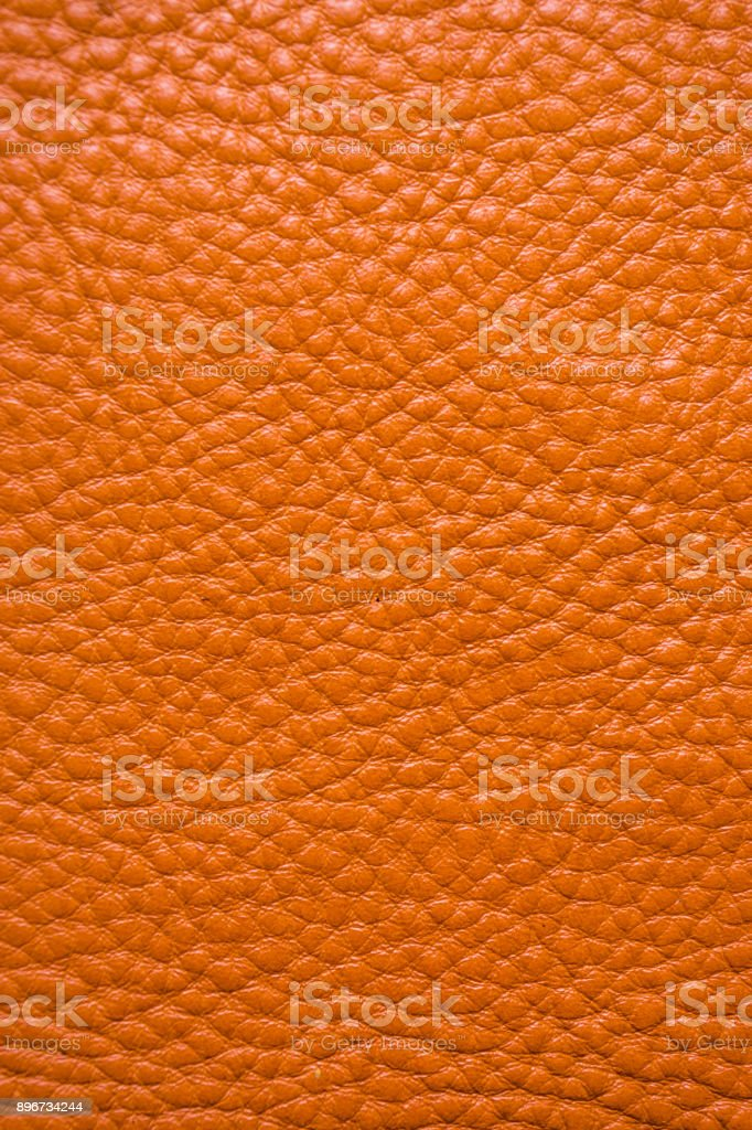 Genuine full grain leather tan color colose up background stock photo