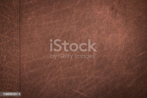 Close up classic brown scratched leather texture background with stitching patchwork. Genuine leather scratched texture