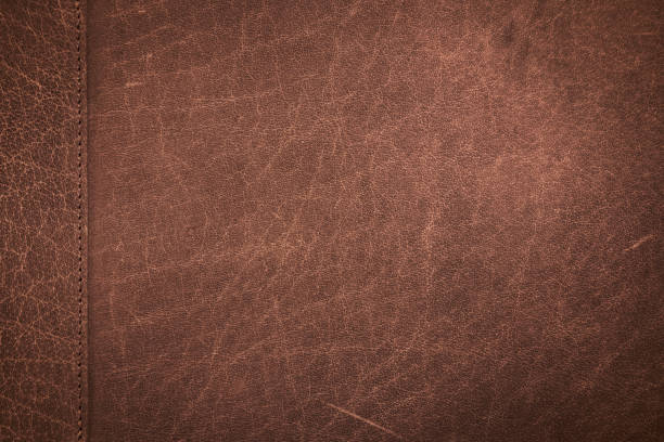 Genuine leather scratched texture Close up classic brown scratched leather texture background with stitching patchwork. Genuine leather scratched texture brown stock pictures, royalty-free photos & images