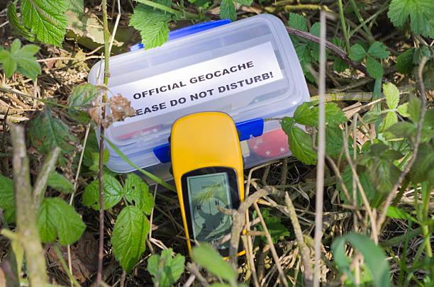 Geocache and GPS Device stock photo