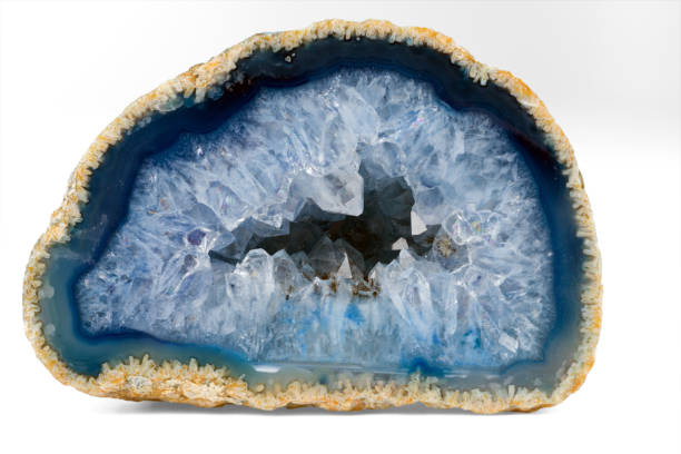 Geode with crystals of light-blue color. Cross section of natural stone Geode with crystals of light-blue color. Cross section of natural stone. geode stock pictures, royalty-free photos & images