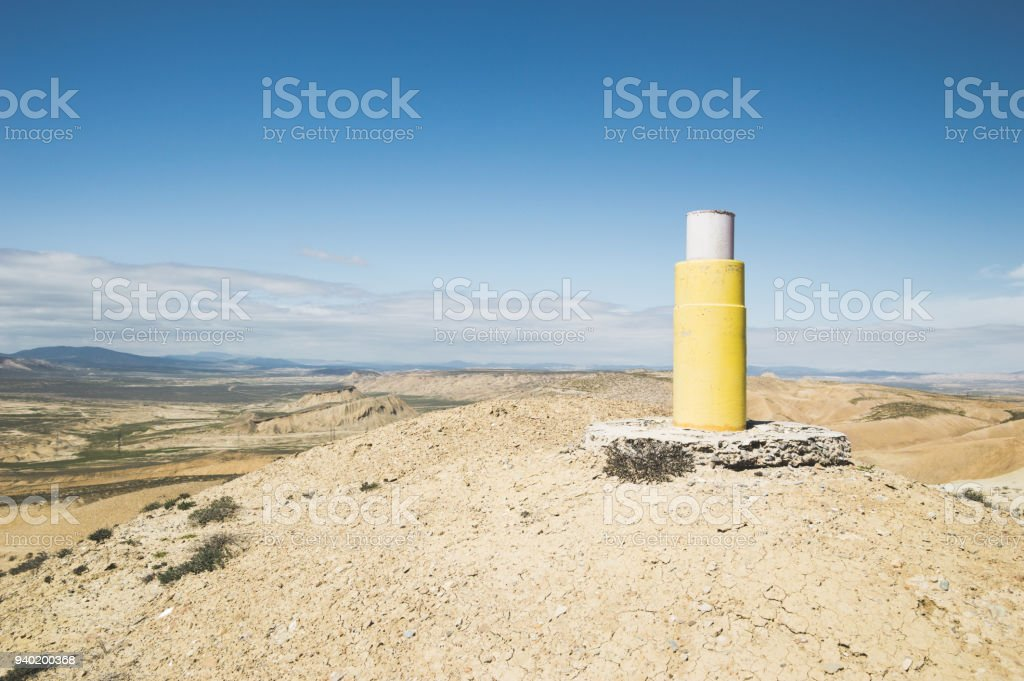 Geodesic mark on the mountain top stock photo
