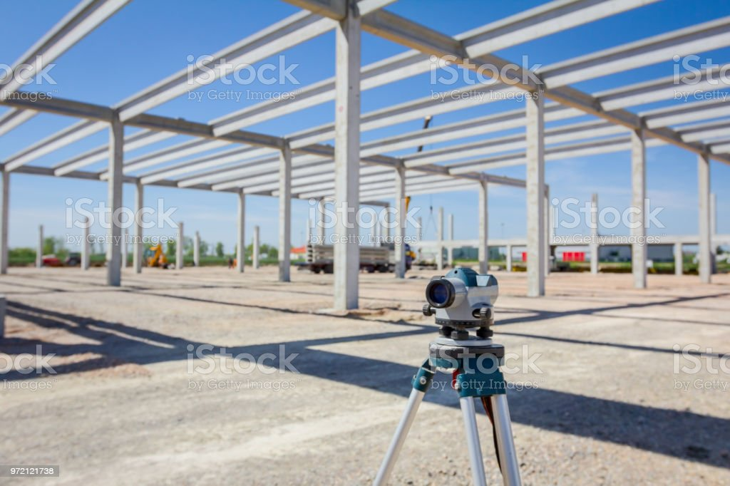 Geodesist device on tripod on a building site stock photo