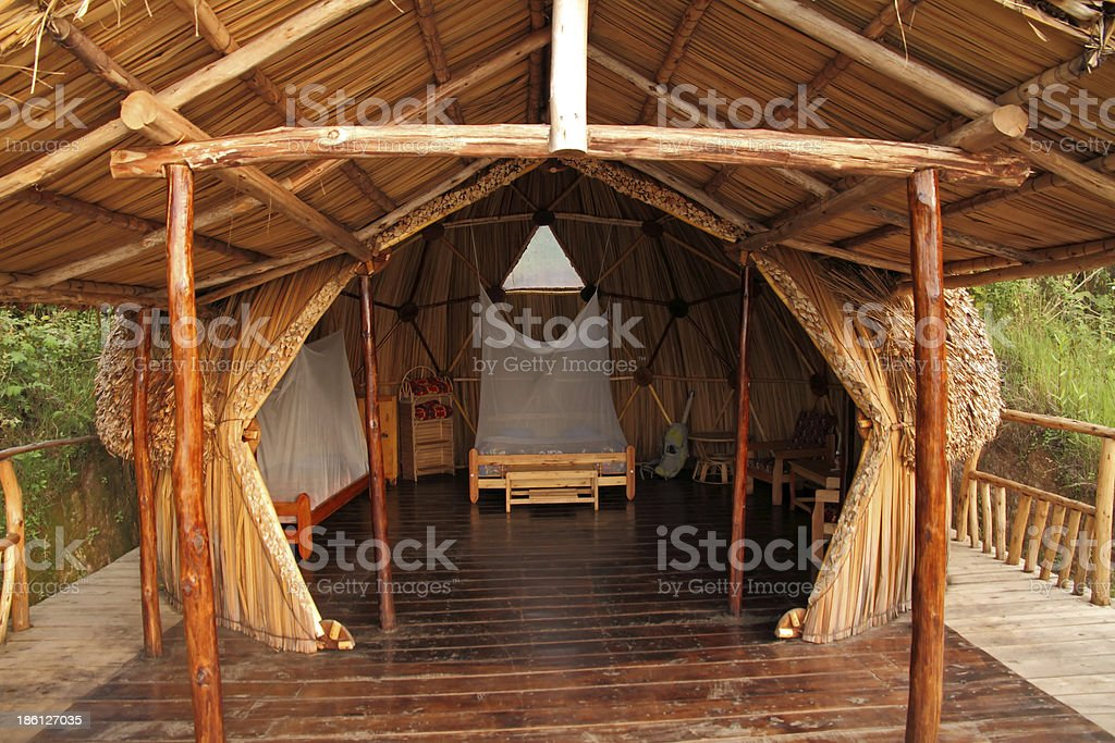 Geodome wood and thatch camping hut stock photo