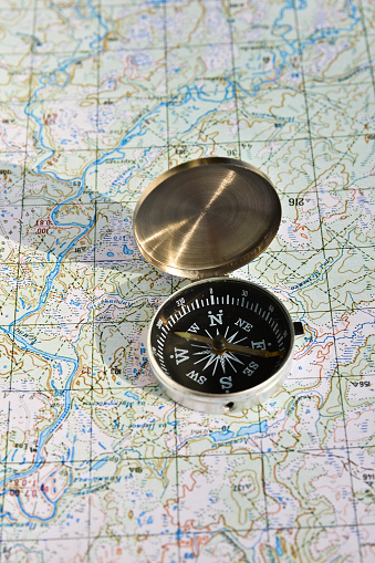 97623256 istock photo Geographical map and a compass. 479377938