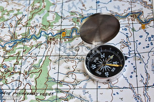 97623256istockphoto Geographical map and a compass. 479377940