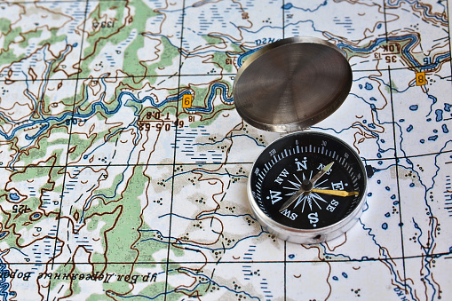 97623256 istock photo Geographical map and a compass. 479377940