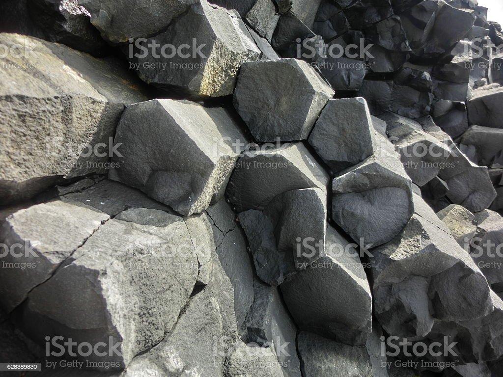 Geological basalt hexagonal rock columns in Iceland stock photo