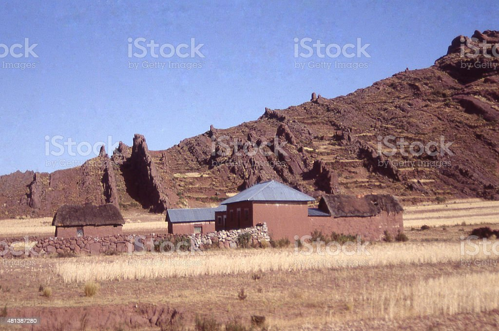 Geological formations farmstead on Altiplano Andes Mountains Bolivia South America stock photo