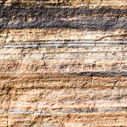 An Australian cliff face showing rock strata laid down over time.