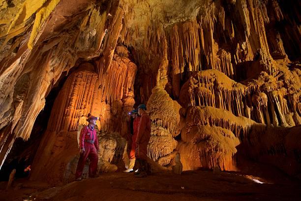 geologist in cave - stalagmit bildbanksfoton och bilder