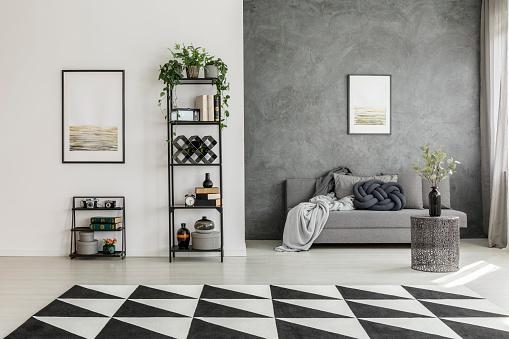 istock Geometric carpet and gray sofa 866539946