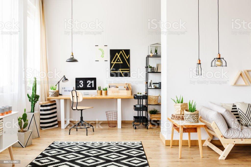 Geometric carpet in multifuncional workspace stock photo