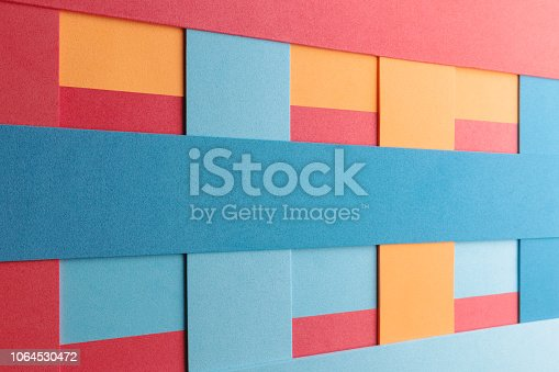 532107582istockphoto Geometric composition with colored elements, abstract background 1064530472