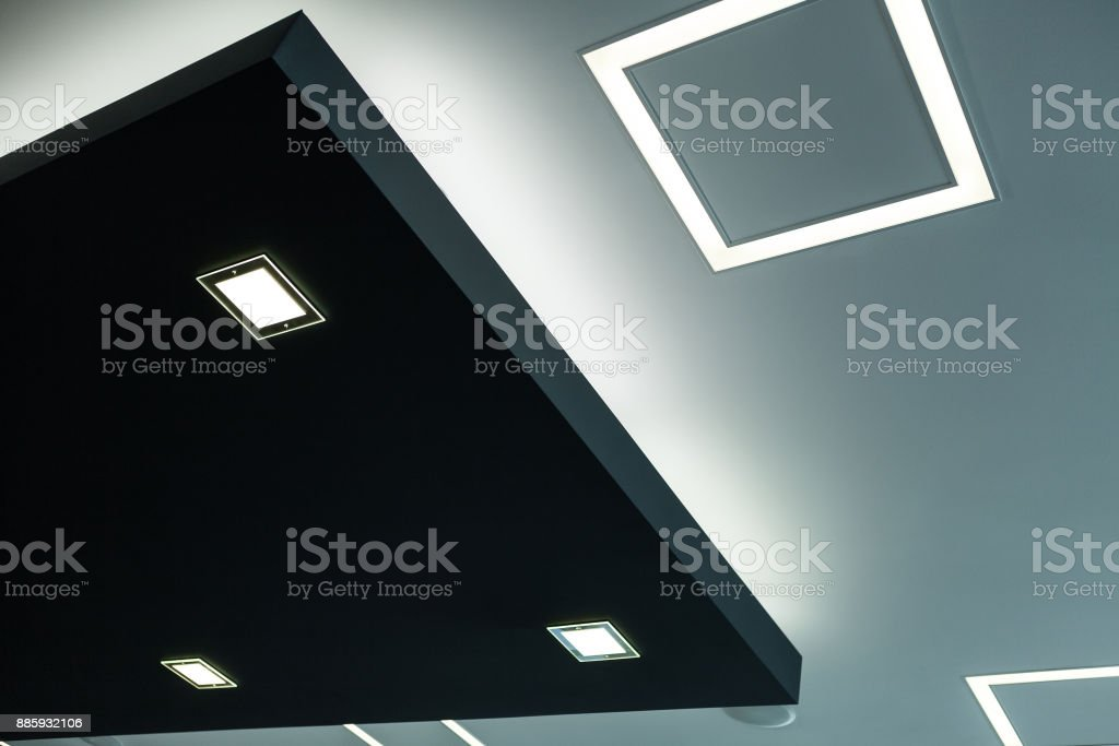 Geometric construction of celling maden with drywall and using modern economical LED light stock photo