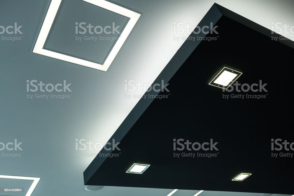 Geometric construction of celling maden with drywall and using modern economical LED light. stock photo