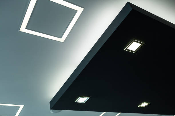 geometric construction of celling maden with drywall and using modern economical led light. - led painel imagens e fotografias de stock