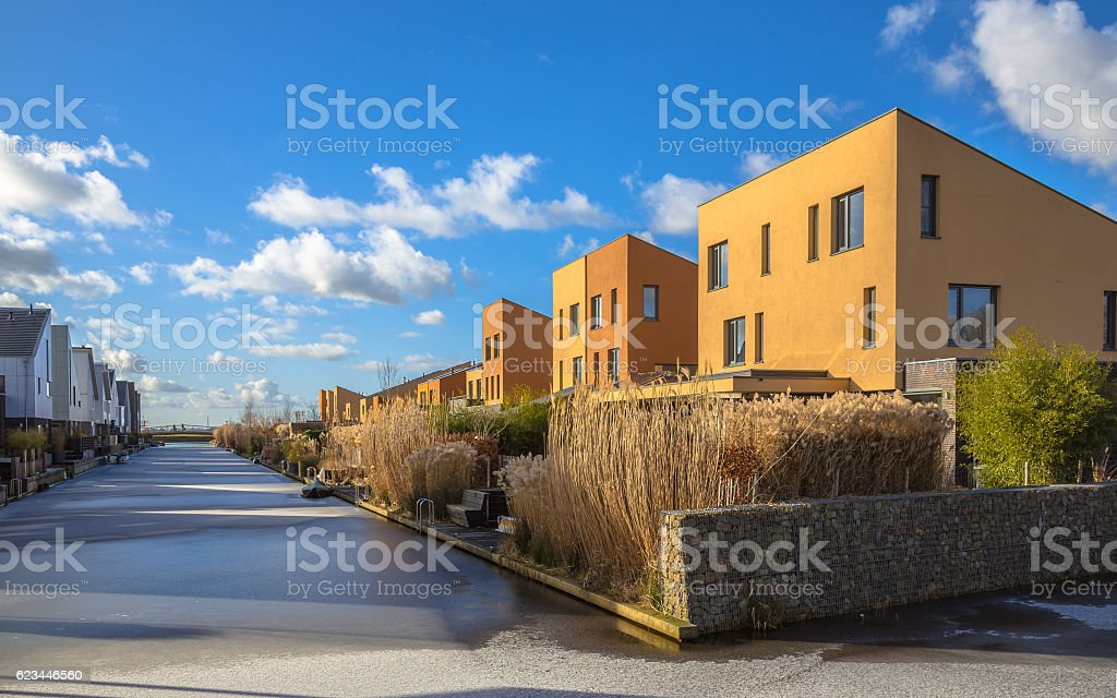 Geometric family houses on the waterfront stock photo