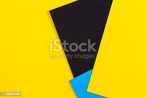 1126531335 istock photo Geometric flat lay yellow blue and black color paper background 1138687660